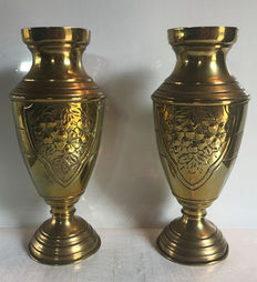 Paire of brass vases with hammered decoration of floral emblems, France, 1950