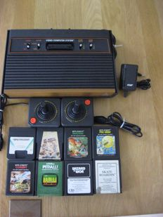 Atari 2600 Woody   Original power , 2 Jousticks and 8 games