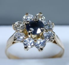 Ring with 8 brilliant cut diamonds of 0.38 ct and 1 sapphire of 0.50 ct, gold 750/1000