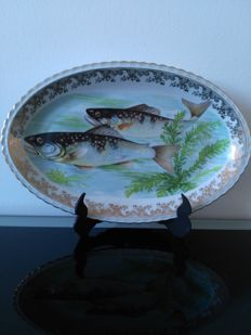 A beautiful fish service, porcelain of Limoges, old, nice decorated.