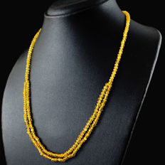 Citrine necklace with 18 kt (750/1000) gold clasp, length 60cm.-