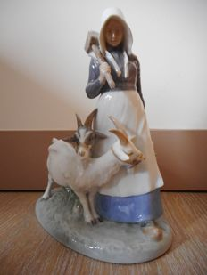 Royal Copenhagen - Figurine of a Shepherdess and 2 goats No. 694 of Christian Thomsen