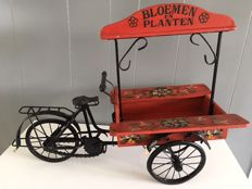 nostalgic big old flower and plant bicycle trailer