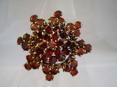 Antique Victorian brooch with faceted, blood-red Bohemian garnets