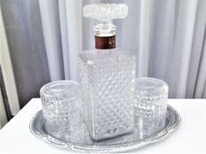 Crystal decanter set on mirror tray