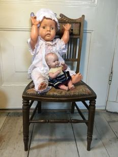 Old decorative chair with dolls, of which one Turtle