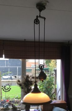 Vintage copper/bronze hanging lamp, which is adjustable in height, with milk glass shade and counterweight