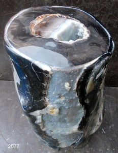 Decoration: Trunk of petrified wood - 30 x 20 x 18 cm - 11 kg - Beautiful crystal formation and a geode on top
