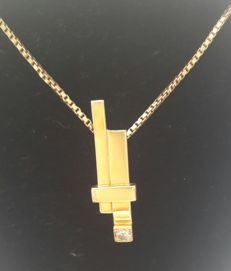 14 kt stylish and modern, by a goldsmith designed gold pendant with diamond, length 3 cm