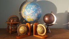 Five world globes.months and constelations depicted , pair of wooden vintage book supports with old world Globes, Spinning Globes,Wereldbol,burn brass
