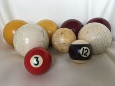 Antique billiard balls of antique white bone and plastic