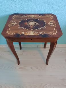 A marquetry table with foldaway top - with music box