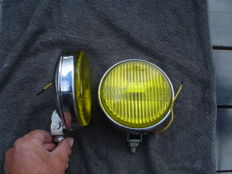 Two FOG LIGHTS of the brand AUTO MAXI with a diameter of 140 mm from the 1960s and 1970s