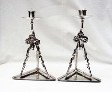 A pair of Art Nouveau candlesticks