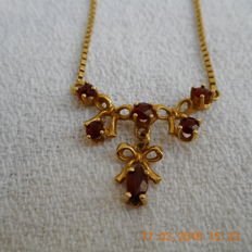 Gold necklace with 6 garnets -