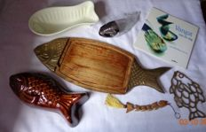 Cutting board, sauce holder, coaster, 2 pudding shapes, key chain all in fish shape, and fish recipe book