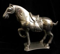 Beautiful, plated silver on bronze, equestrian sculpture of a robust horse, richly harnessed, with golden bindings - 20th Century