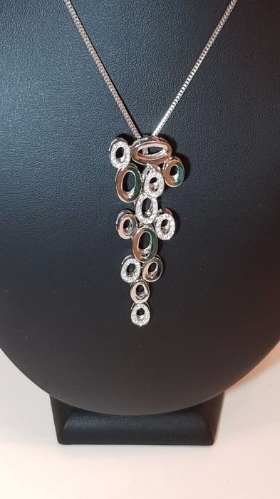 Necklace of Italian design. White gold and diamonds. The necklace is 48 cm long.  The pendant measures 6 × 2.3 cm.
