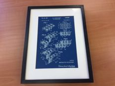 Blue print patent application LEGO brick in frame. Reproduction engraving in blue plastic.