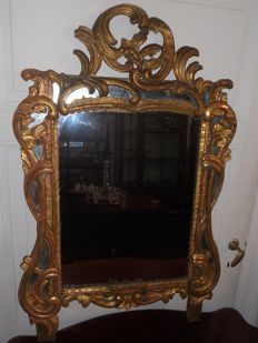 Rococo-style wall mirror in frame of gilded patina on wood - France, 18/19th century