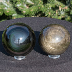 Fine set of Gold and Rainbow Obsidian spheres - 69 mm and 74 mm - 902 g  (2)