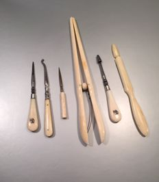 "Six different bone instruments with metal, sewing kit and ""glove finger tongs /pliers"" - circa 1900"