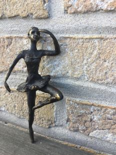 Mysterious anonymous bronze statue of ballerina