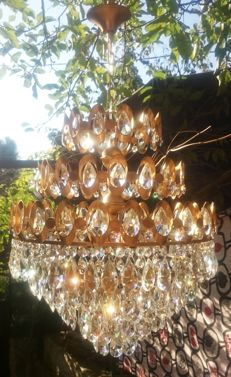 A brass and crystal chandelier, of recent manufactue