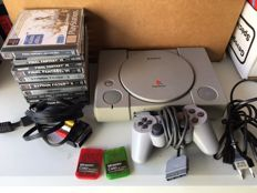 Playstation 1 + 8 games.