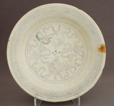 Contoured Ming dish, decorated with temple (guardian)lions playing with balls, partly polychromed