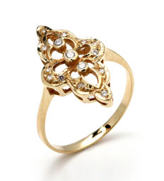 Ring of 18 kt yellow gold and zirconias
