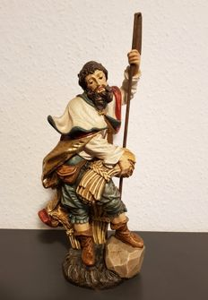 Wooden figure of St Isidore
