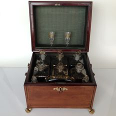 Liqueur cabinet of yew, ebony, and lime wood with band intarsia and two brass handles - Holland - 19th century