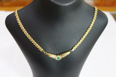 Ladies' 18 kt/750 gold necklace with one 0.50 ct emerald and eight zirconias surrounding it, with 10 more small zirconias in carre.