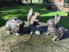 Three bronze animal statues, two rabbits and a squirrel