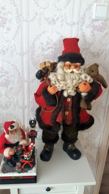 Large Father Christmas with packages + small Santa Claus as a music box with illuminated lantern