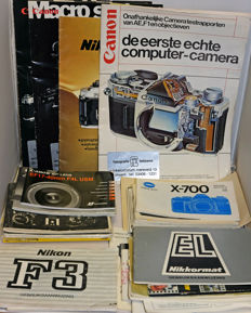 Various user manuals for Minolta, Nikon and Canon