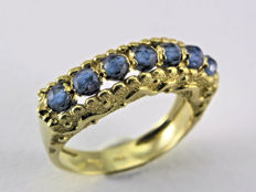 New women's 18 kt yellow gold with 7 briolette-cut blue topaz stones -- weight: 7.10 g -- ring size 15 (international size) with optional size adjustment