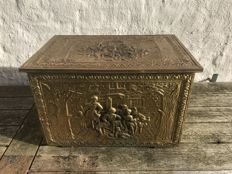 Beautifully ornamented brass peat box.