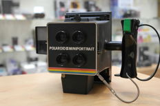 Polaroid Mini Portrait passport photo camera with back and Polaroid roll cutter