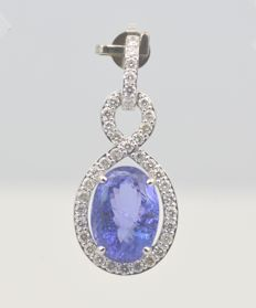 14k White Gold Tanzanite 6.14ct & Diamond 0.75ct  Pendant , Size L 25mm x W 14mm. Total Weight 4.41grms