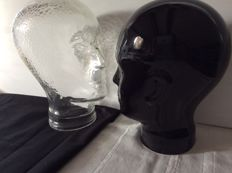 Two decorative heads, one made of pressed glass and one of ceramic