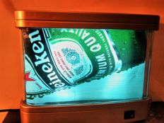 HEINEKEN. Illuminated, moving / rotating, floating advertisement. Limited edition - occasional 1 piece from ten (01/10). Dimensions: 26/22 / 9cm.