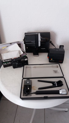 Lot. 5 cameras   1 vintage Lot of 5.  Polaroid 635CL.   1. Super 8 camera Argus 803. 1. Fujifilm camera DL-270 zoom.   1. Microphone Grundig. 3 pieces 1970s    1 DACORA dignette