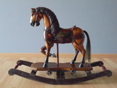 Solid wooden hand carved rocking horse