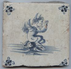 Antique tile with the image of a sea creature - sea Monster or a devil?