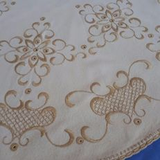 Hand-embroidered tablecloth. Italy