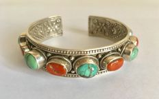Richly decorated silver bracelet with turquoise and coral