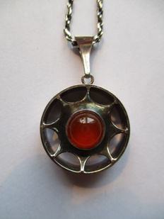 Silver pendant from Finland on silver necklace, 925 sterling silver and 835 silver. Centre stone Carnelian.