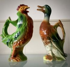 St. Clement - Two polychrome majolica water jugs 'Duck and Rooster'